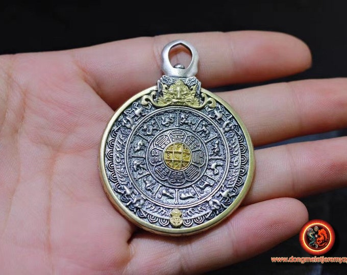 Buddhist amulet, Tibetan protection. Wheel of Buddhist life rotating on both sides. Silver 925 and copper.