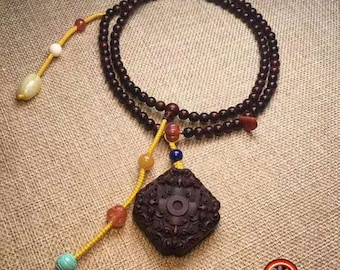 Mala, Buddhist rosary. 108 red sandalwood beads, turquoise, agate called nan hong, fossil mammoth, lapis lazuli, silver 925