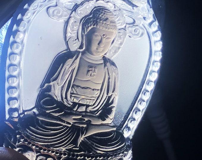 Amulet, Buddhist pendant. Obsidian ice. Amitabha, Buddha dhyana, meditation Buddha of the pure lands of the west