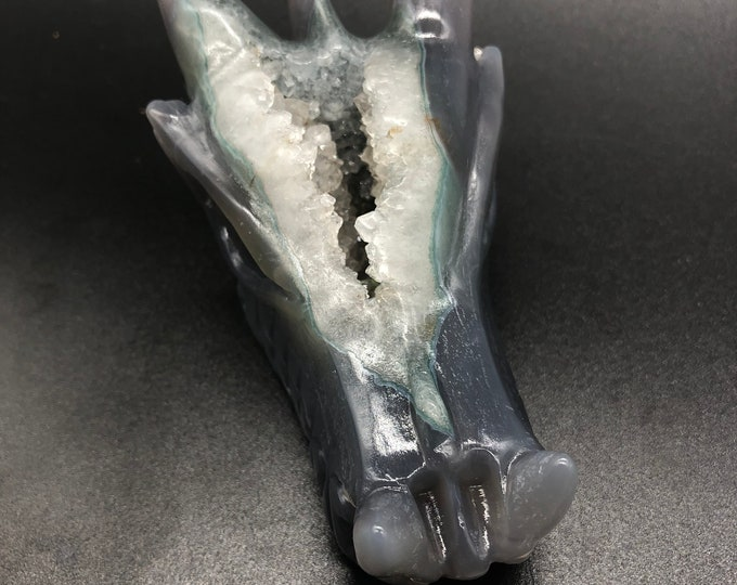 crystal dragon skull. Hand-carved dragon in a quartz geode on rock crystal and agate gangue. Unique piece