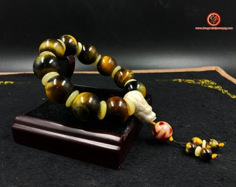 big dragon head bracelet. 18mm diametre tiger eye, yak bone, tibetan sacree agate ''DZI'