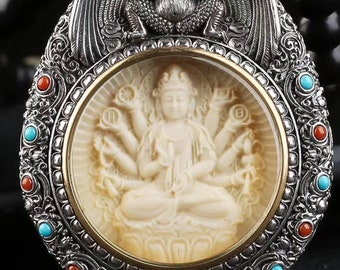 Amulet, Tibetan Buddhist protection reliquary Chenrezi and Garuda mammoth ivory, solid silver 925. mantra turning on the back