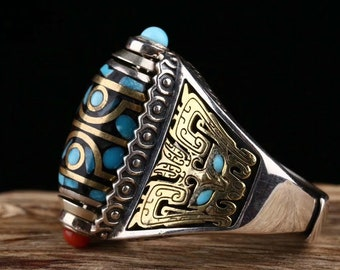 Tibetan Buddhist ring. DZI or sacred celeste stone of Tibetan protection with eight eyes. Pattern Taotie Silver 925, turquoise and nan hong