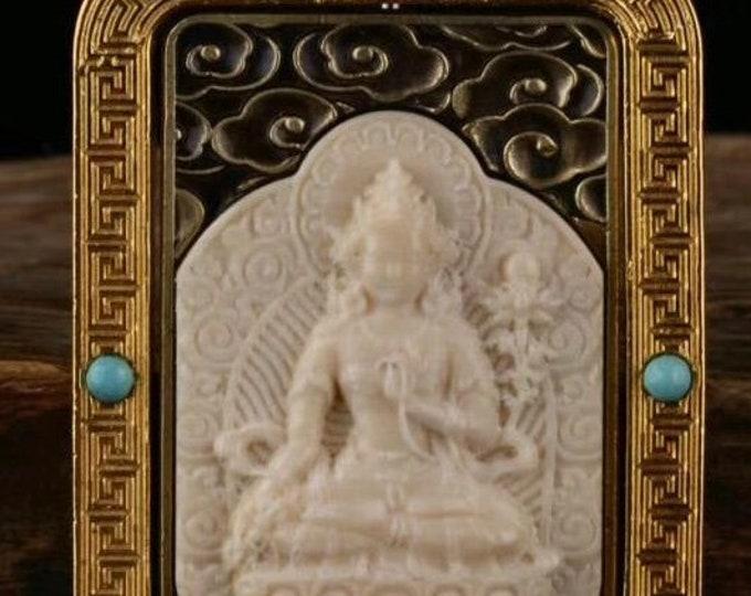 reliquaire protection bouddhiste tibetain  Manjushri , ivoire de mammouth, argent massif 925, bronze turquoise, agate dite nan hong.