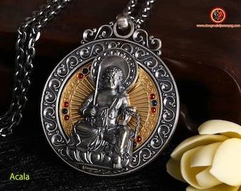 Pendant, Buddhist protective amulet, Acala Buddha. revolving wheel on the back of the Buddha, Tibetan mantra on the back of the amulet.