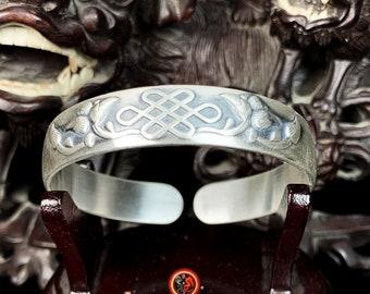 "950 silver Buddhist rush bracelet. Infinity knot ""Buddha's Wisdom,"" fish ""free of rebirth"""