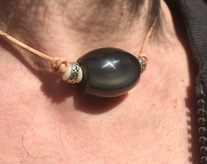 Necklace barrel Obsidian celestial on leather cord.