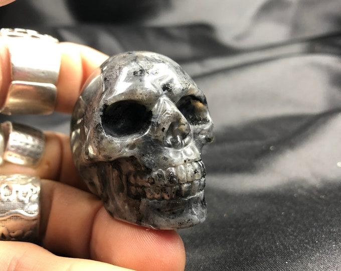 Crystal skull. Skull carved with grey labradorite hand. 5cm in length.