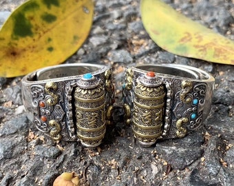 Tibetan Buddhist ring. Prayer mill mantra of compassion. Silver 925, turquoise copper and nan hong