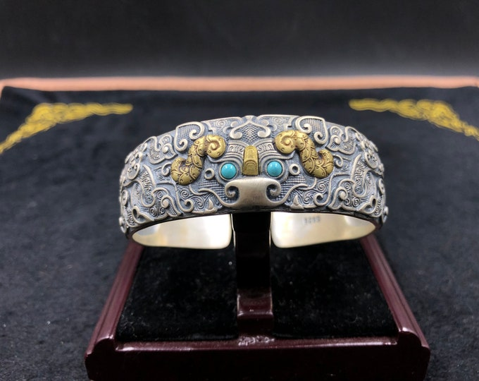 """Feng Shui junk bracelet. Protection of the taotie dragon. Silver 925, copper. Turquoise from Arizona, agate called """"nan hong (red south of Yunnan)"""