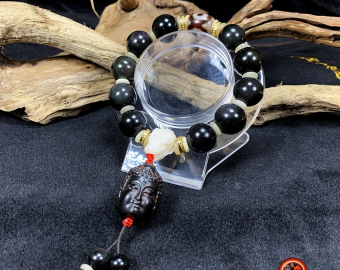 Bracelet, wrist mala. Mala Tibetan. Bracelet in obsidian celeste eye. Tibetan sacred Agate, DZI. Mala 10 beads. Carved Buddha.