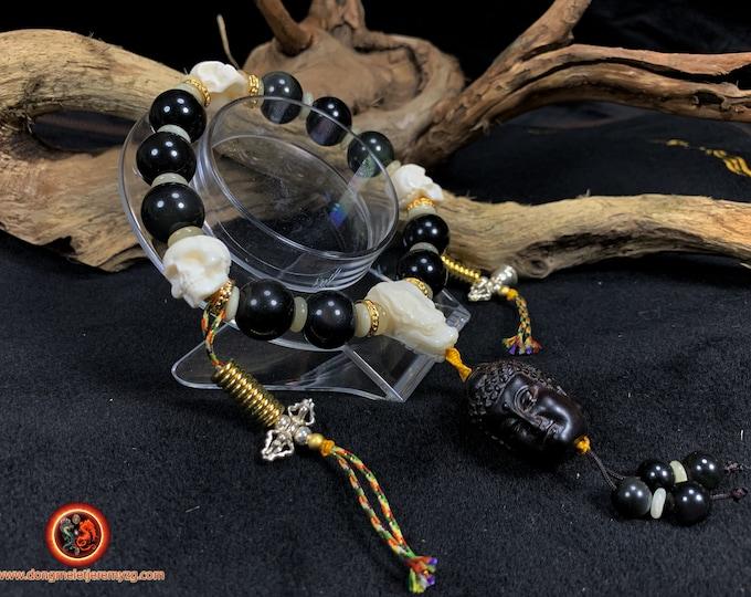 Bracelet, wrist mala. Mala Tibetan. Bracelet in obsidian celeste eye. Cranes, bone dragon.  Mala 10 beads. Carved Buddha.