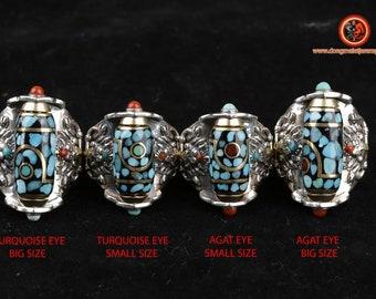 Tibetan Buddhist ring. DZI or sacred celeste stone of Tibetan protection turning representation of Garuda, silver 925, turquoise.