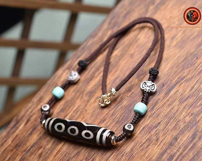 "Authentic DZI, Tibetan sacred agate. DZI, said ""has 6 eyes"", 6 eyes DZI. powerful Tibetan protection. Copper clasr. Turquoise"