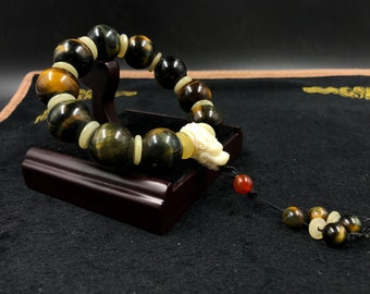 big bracelet dragon tiger eye / falcon, buffalo bone carnelian beads of 18mm.