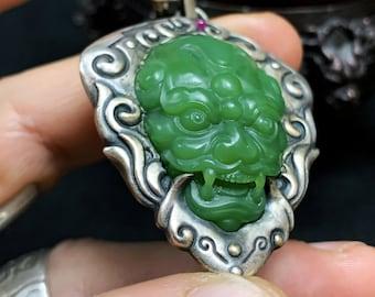 "Feng-shui pendant. Taoist protective amulet. Jade guardian demon says ""polar jade."" 925 silver. Grenat tsavorite. Ruby."