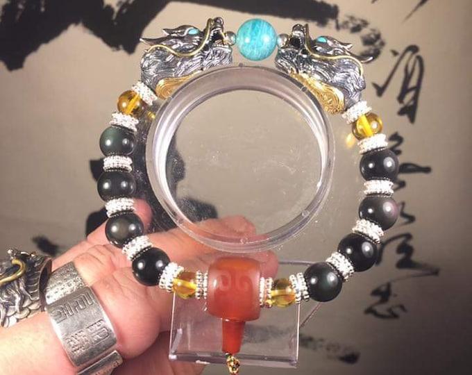 Double dragon bracelet. Silver 925 copper, Amazonite of Lake Baikal; Obsidian celeste eye, cornaline, Burmese amber, Arizona turquoise
