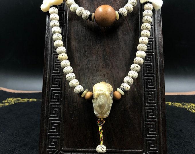 mala, Buddhist rosary, 108 pipal seeds, yak bone dragon, sandalwood, agate sacree tibetaine DZI. tibetan dorje and drillou