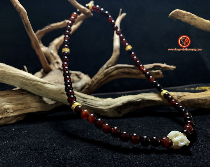 necklace and bracelet crane, skull. Horn and buffalo bone, gold plated copper 24k. Mounted on ultra resistant extendable cord.