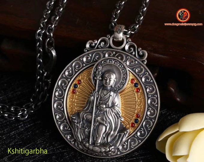 Pendant, Buddhist protective amulet, Buddha Kshitigarbha rotating wheel on the back of the Buddha, Tibetan mantra on the back of the amulet.