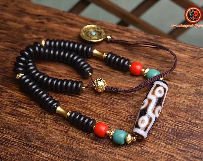 Authentique DZI, agate sacrée tibétaine . DZI, dit a 9 yeux. puissante protection tibétaine.cuivre. Turquoises. Tigle tibetain en finition.