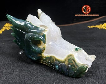 crystal dragon crane. Dragon carved by hand in a quartz geode on rock crystal gangue and agate. Unique piece
