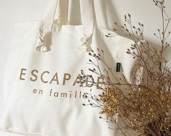 "White ""Family Getaway"" bag"
