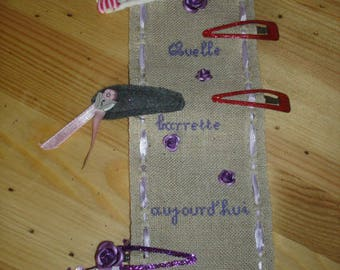 hanging purple embroidered linen strips