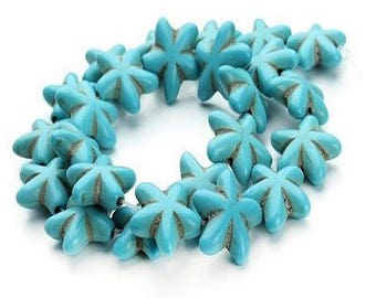 Ceramic, turquoise beads in the shape of starfish.