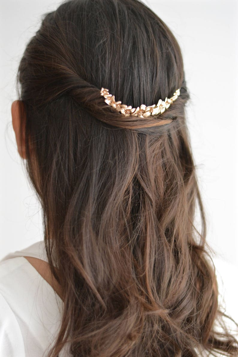 Applying hair gold fairy antique and delicate romantic boho wedding jewelry. Half Crown flowers gold leaves bridal comb
