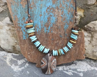 Ethnic, boho and rustic necklace in raw ceramic and heishi pearls.....