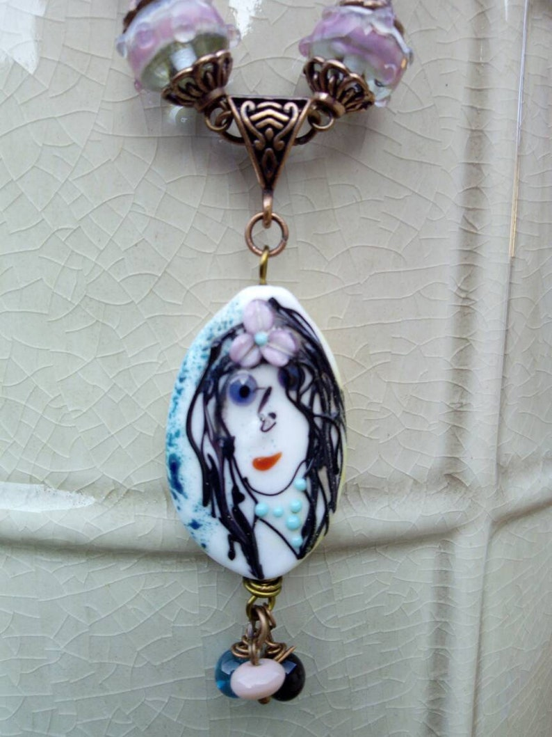 lobster clasp copper metal The Lady on glass bead spun torch pendant
