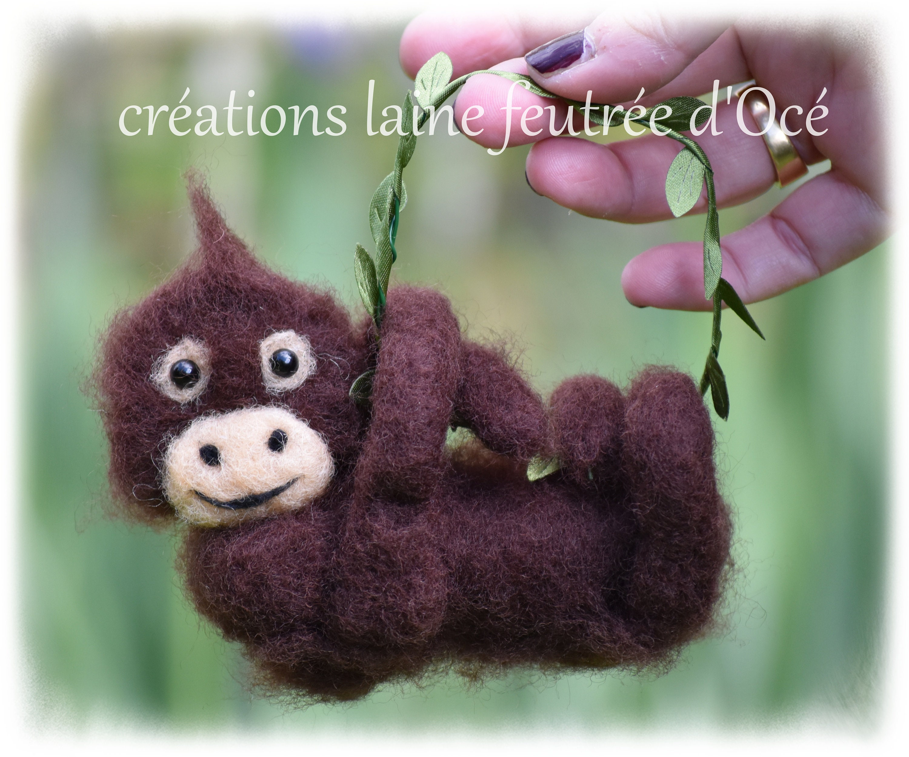 made in a painting Oerang oetan baby felted With the handmade.