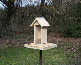 Feeder has birds in natural untreated pine wood