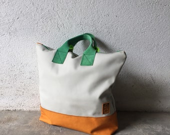 Woman colored leather Hand bag