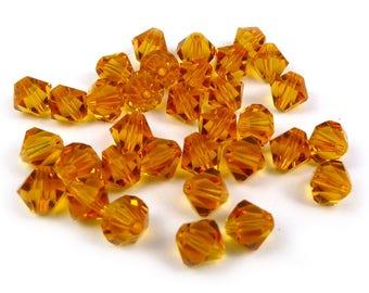 20 x Swarovski® 6 mm TOPAZ Crystal bicones