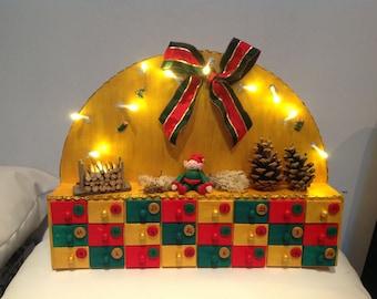Wooden Christmas advent calendar. Pixie