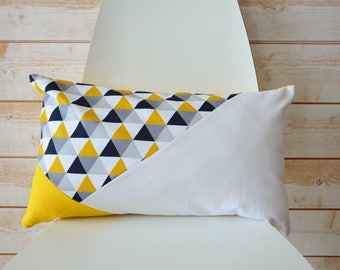 Rectangle cushion with cuts of color