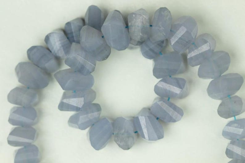 5 x 8 mm approx 10 inch long strand faceted BLUE LACE twisted rondelle beads 4 x 6