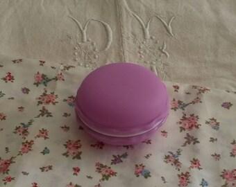 Purple round box shaped badge