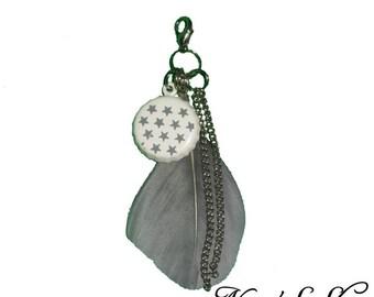 Grey bag jewellery, feather & Cap