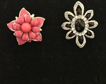 Pink floral ring. Black floral ring. 2 floral rings