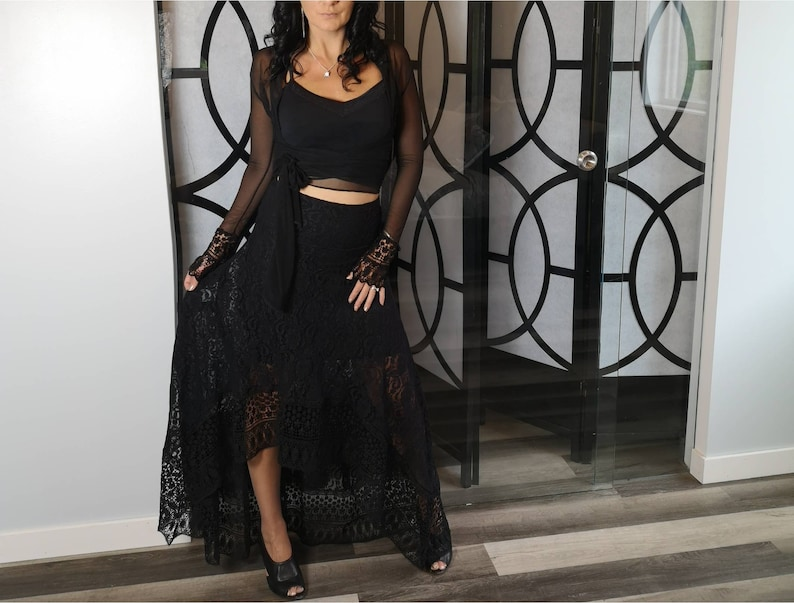 Long high low black lace skirt This skirt is very flowy with a fitted lining underneath high waistband embroidered lace on the bottom.