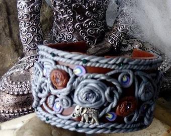 Unique bracelet made of polymer clay elephant