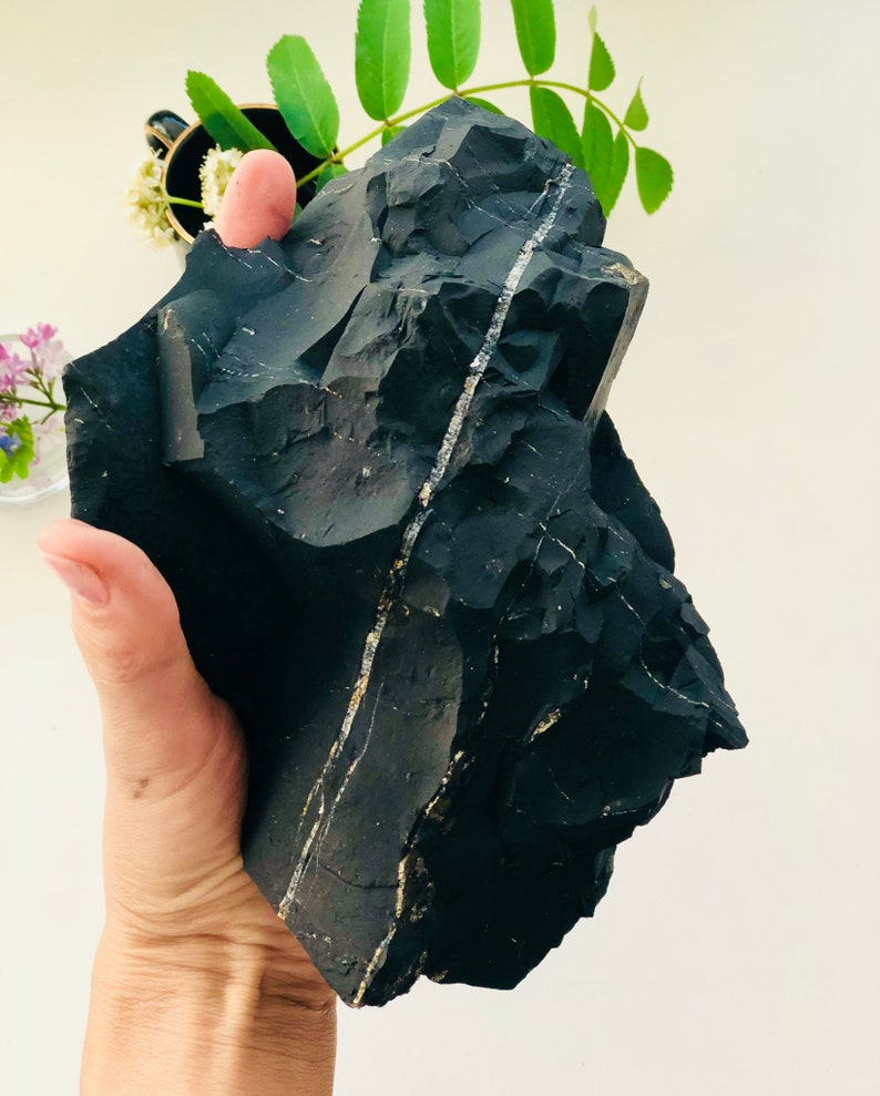 A piece of Zazhoginskiy shungite with the traces of quartz