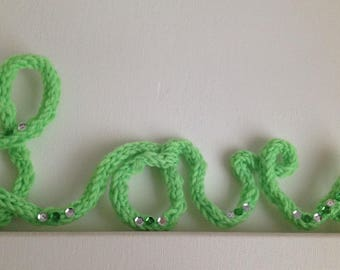 "Say it with words ""LOVE"" wall decor in lime green knitting"