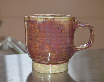 Small cup with two finger handle