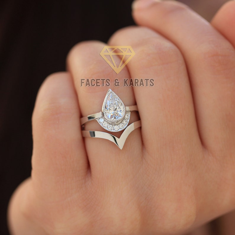 f5e3f6d60f26 Unique Pear Shaped Engagement Ring with Nesting Wedding Band