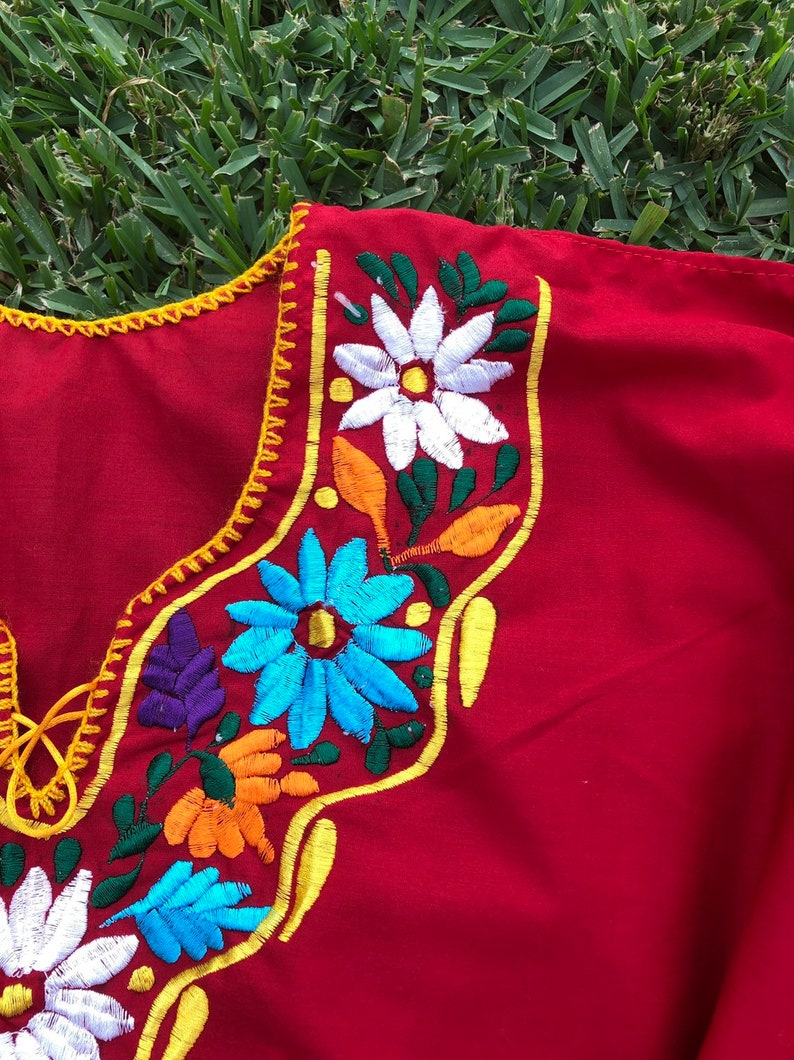 24at the bust  waist area is free X Large Red Mexican Embroidered Blouse  measures
