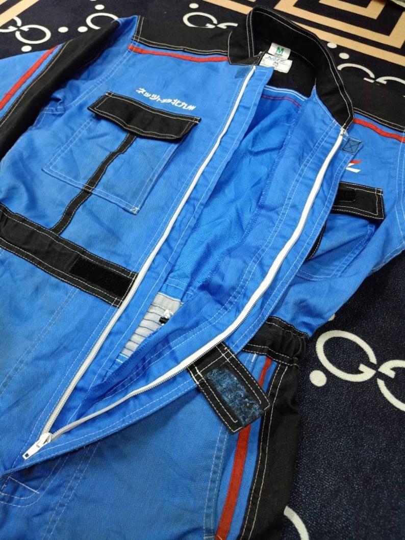 NETZ Toyota Kitakyusyu X Three Monkey Vintage Clothing Big Logo Spell Out Full Zipper Straps M Size Coverall Overall.